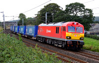 DBS 92016 passes Burton on 7.9.11 with the Tesco Express.
