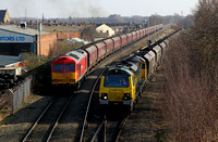 70004 pulls past 60011 as it departs Latchford Sidings with its Ellsemere to Fiddlers Ferry service.