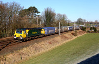 70005 heads past Hincaster with its Coatbridge to Daventry.