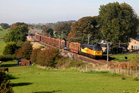56087 heads towards Galgate on 28.9.13 with the Carlisle to Chirk logs.