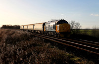 Looking ex works, 37424 heads the 1004 Preston to Barrow-in-Furness past Silverdale crossing.