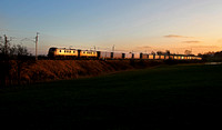 90047 & 90046 head past Woodhouse with 4S44 on 8.1.18 as the sun starts to set.
