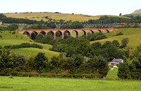 92001 heads past Beckfoot with 4S43 on 28.6.11. The disused Lowgill viaduct is in the foreground.
