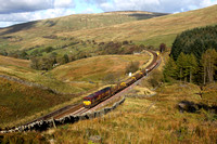 66149 heads towards Blea Moor Tunnel with 6K05 on 19.10.11