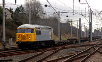 British & American Rail Services 56311 passes Carnforth with a Stoke to Motherwell wagon move.