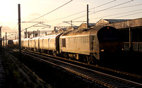 67027 passes Carnforth with 1S07 Willesden to Shieldmuir on 15.12.11.