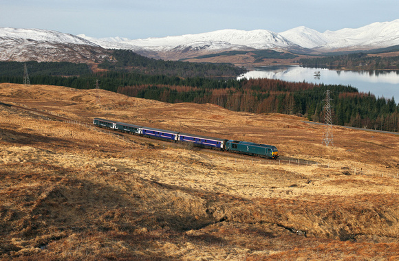 Newly liveried 67004 heads towards Achallader on 2.4.15 with Sercos Fort William sleeper service.