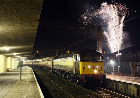 47832 waits at Carnforth with the 'Guy fawkes' Northern Belle as a fireworks display is set off.