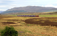 67007 heads towards Crubenmore with the Calendonian sleeper for Inverness.
