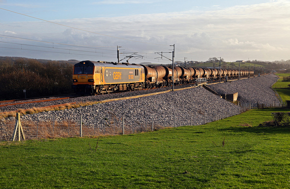 92032 heads away from Carnforth with a late running 6S94 Dollands Moor to Irvine on 1.3.17.