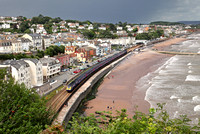 A Penzance service passes Dawlish on the 12.8.14 as a storm brews behind.