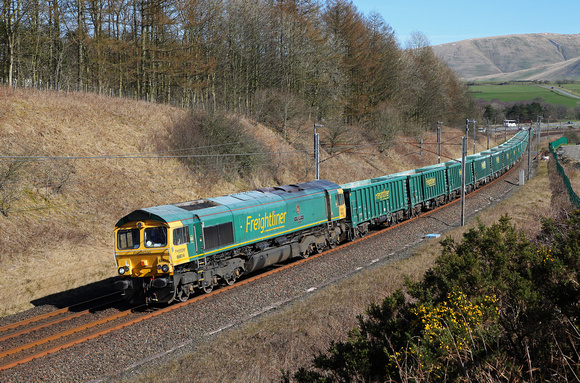 66614 passes Beckfoot on 25.3.17 with the 0935 Hardendale Quarry to Guide Bridge Yard.