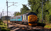 37409 heads the return working past Bolton Le Sands on 7.9.15.