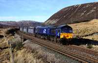 66305 heads away from Drumochter with the Inverness to Mossend Tesco train on 3.3.17.