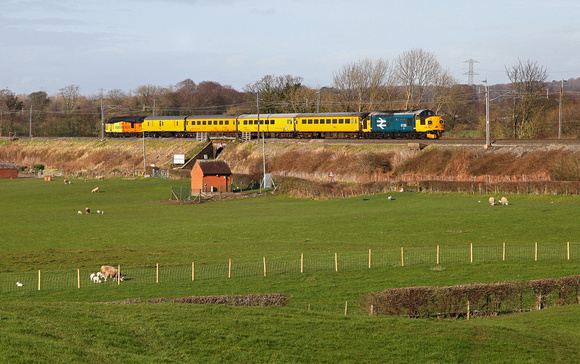 37116 & 37025 head past Bay Horse with a Derby to Carlisle test train via the Cumbrian Coast.